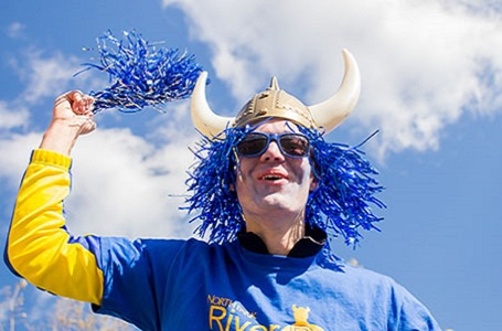 Student dressed up as a viking cheering